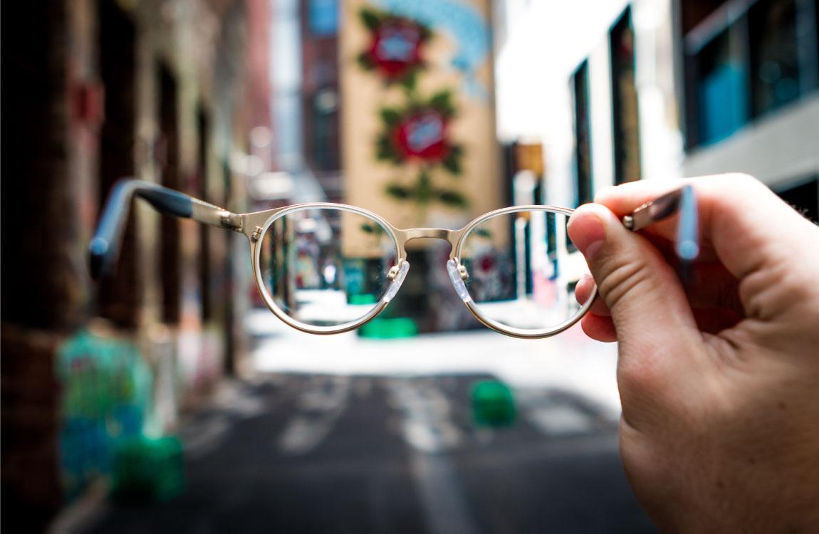 hand holding glasses focus